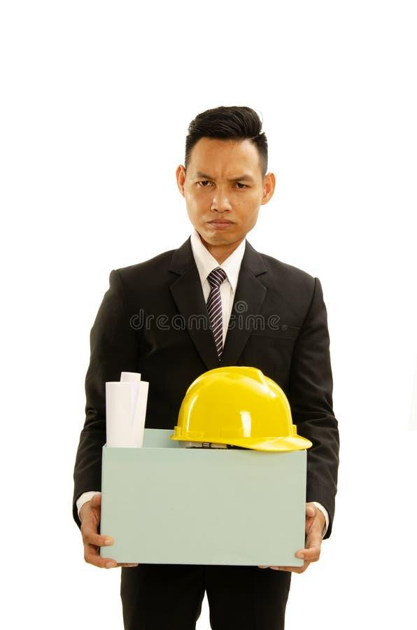 归档坏举行的纸板箱的亚裔商人对resignati 免版税图库摄影