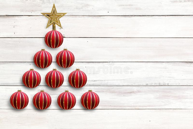 当与金黄星的圣诞树装饰的红色中看不中用的物品球在假日庆祝卡片和设计的土气白色木板 图库摄影