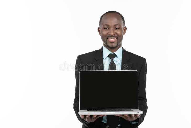 当前在膝上型计算机的商人 免版税图库摄影