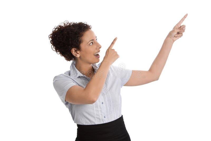 当前斜向一边与手指的被隔绝的女实业家 免版税库存图片