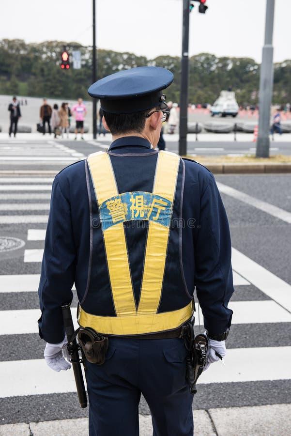 当班日本的警察 免版税库存图片