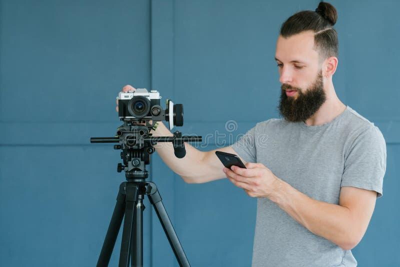 录影射击人照相机设置检查电话 库存照片