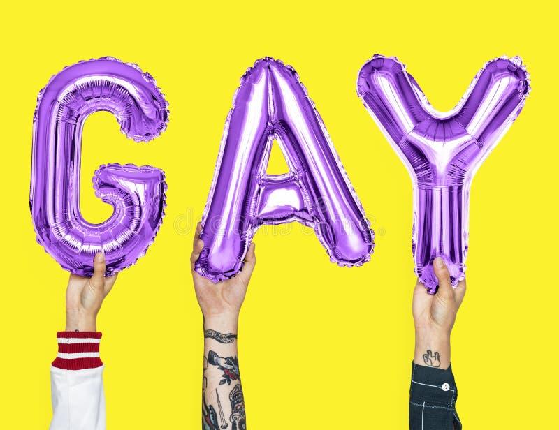 形成词同性恋者的紫色字母表气球 免版税库存照片