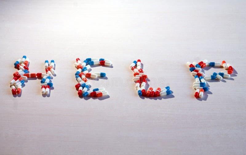 形成词帮助的色的医药胶囊 库存照片