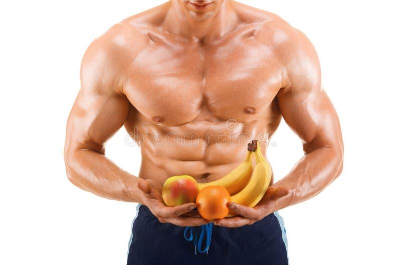形状和健康身体的人拿着新鲜水果,形状胃肠,隔绝在白色背景 免版税库存图片