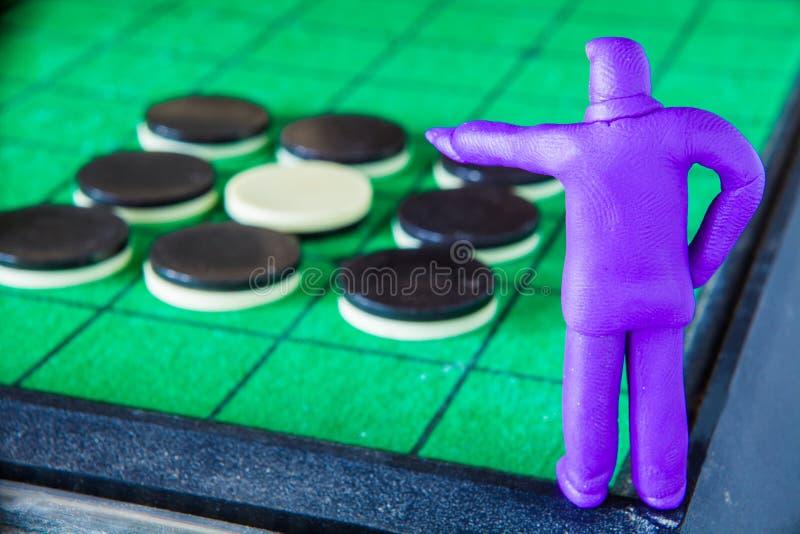 彩色塑泥商人命令采取行动对比赛 图库摄影