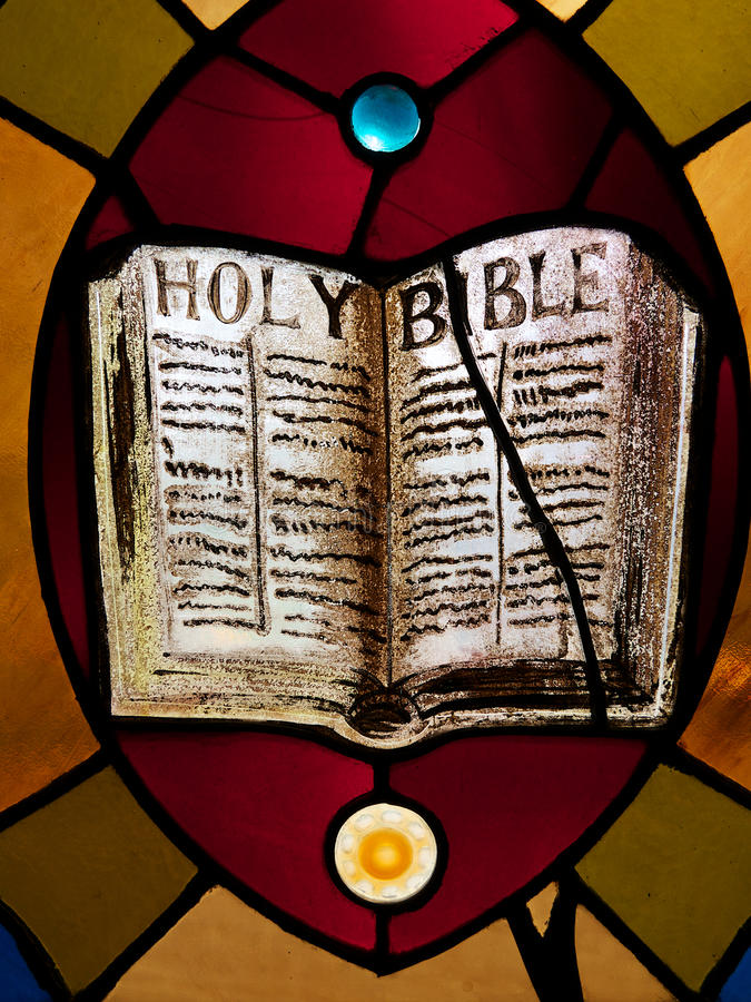 彩色玻璃圣经 免版税图库摄影