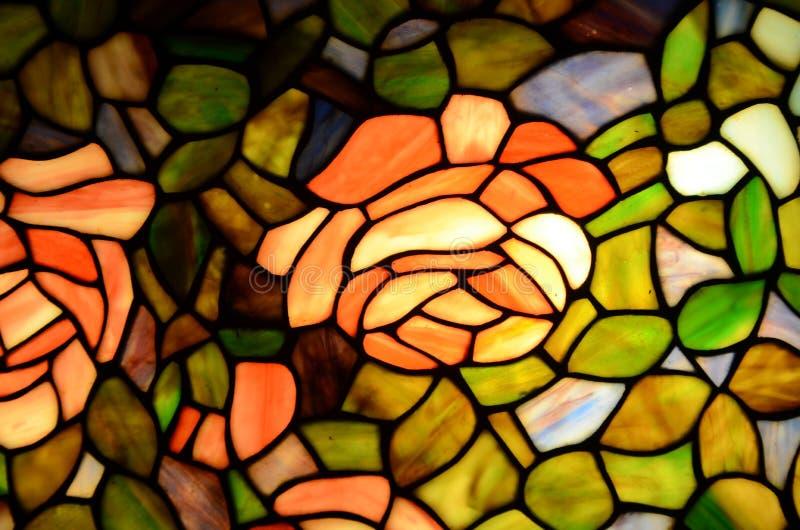 彩色玻璃玫瑰和绿叶 库存照片