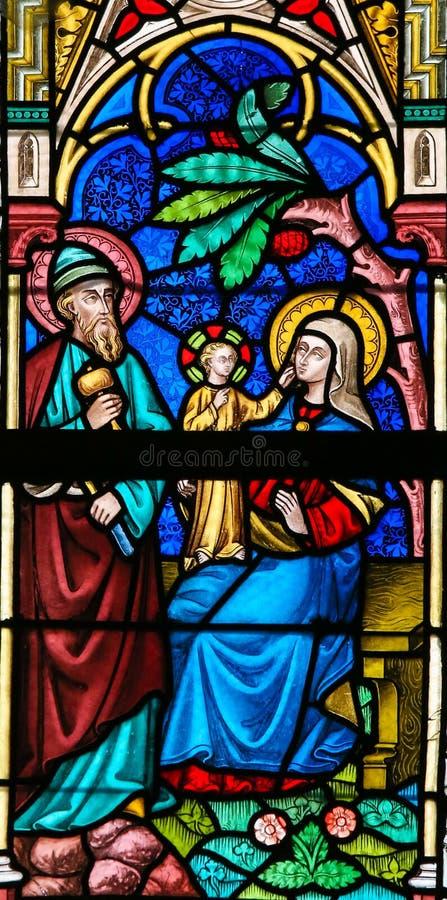 彩色玻璃-圣洁家庭 库存照片