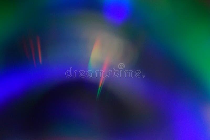 彩虹光泄漏有黑背景 免版税图库摄影