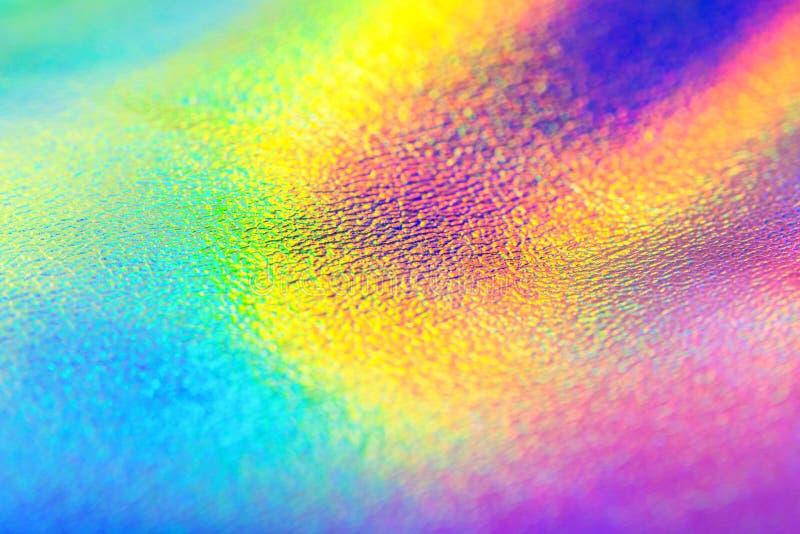 彩虹真正的全息照相的箔纹理背景 免版税库存照片