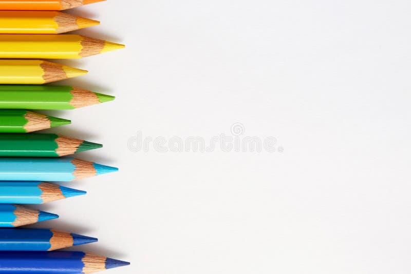 彩虹色的铅笔肩并肩轻摇 库存图片