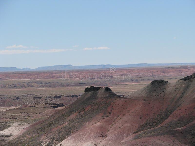 彩绘沙漠倾斜的小山  库存照片
