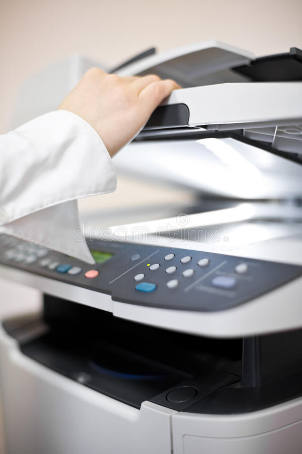 影印机现有量s妇女 免版税库存图片