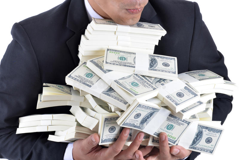 很多金钱在一个年轻商人的手上 库存图片