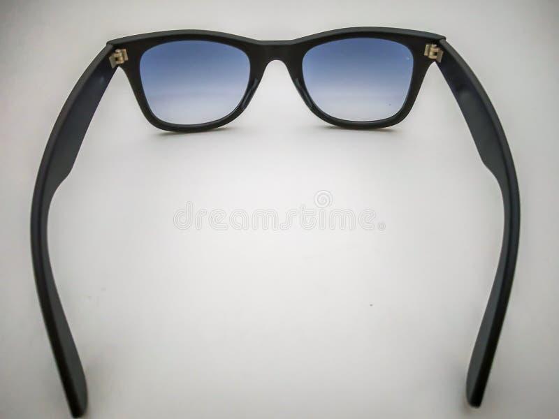 徒步旅行者太阳镜有白色背景 库存图片