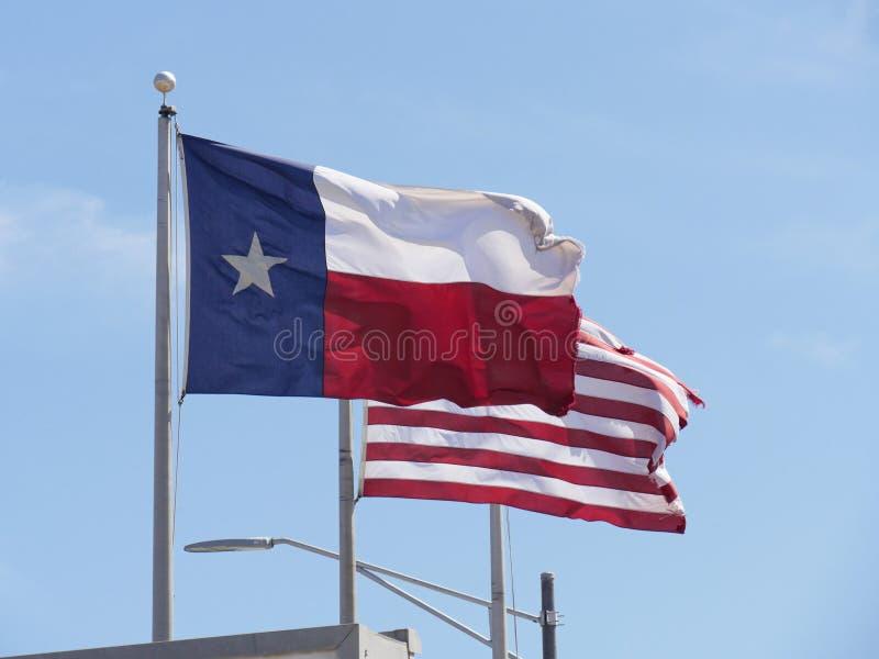 得克萨斯和美国旗子 图库摄影
