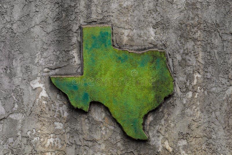 得克萨斯塑造了在石墙上的难看的东西质感粗糙的具体装饰 免版税库存图片