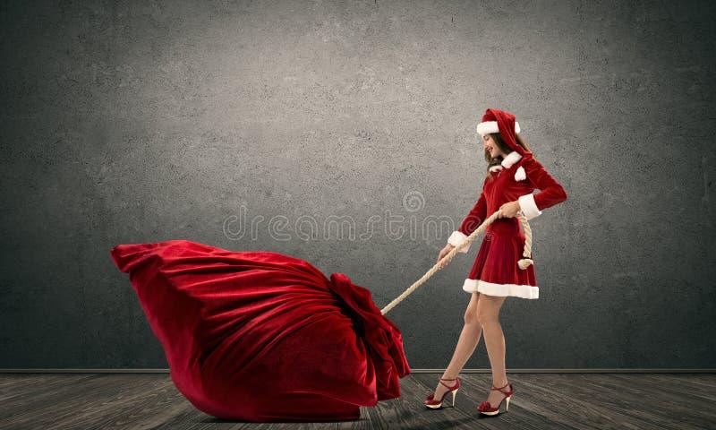 得到您的圣诞节礼物 免版税库存图片