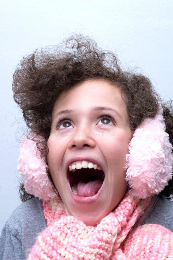 御寒耳罩女孩粉红色围巾 库存照片