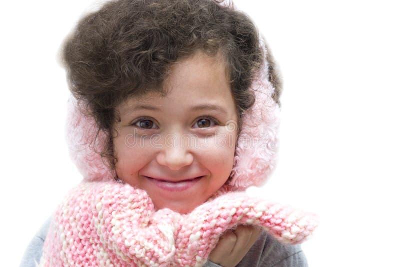 御寒耳罩女孩粉红色围巾 图库摄影