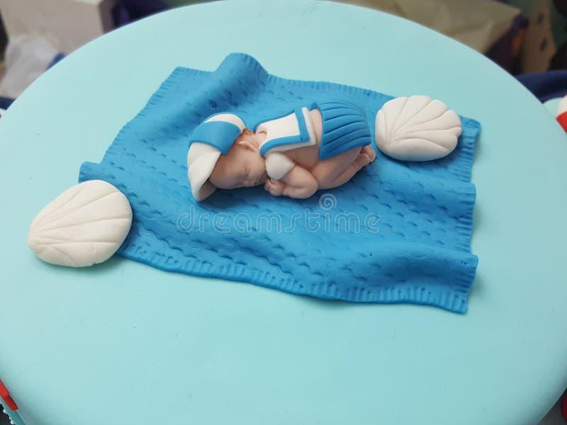 微型婴孩蛋糕装饰 免版税库存照片