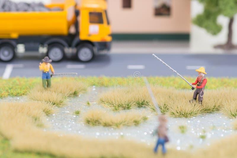微型渔夫临近路 库存图片