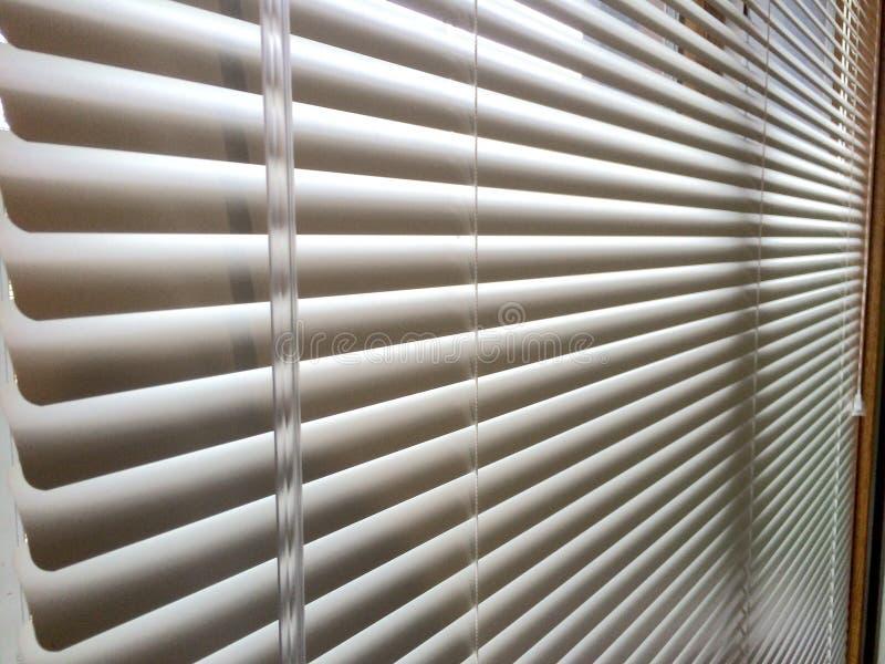 微型窗帘窗口鞭子 免版税库存照片