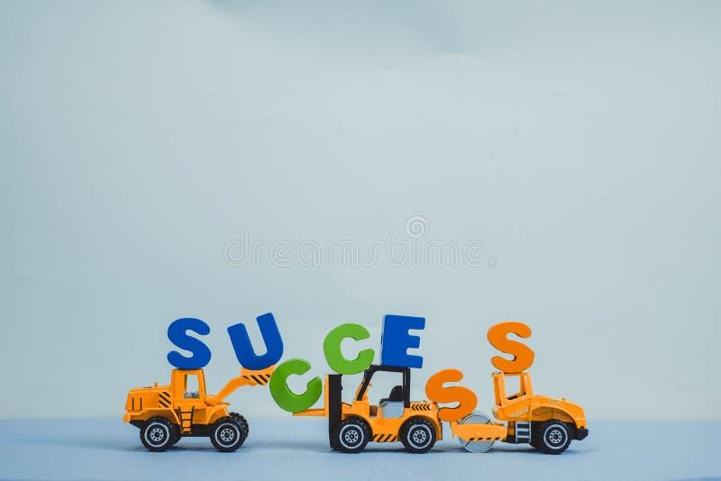 微型铲车推土机卡车和压路机机器有文本的 图库摄影