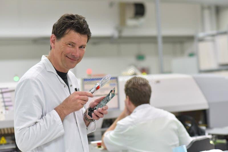 微电子学装配的工业工厂-设计c 库存图片