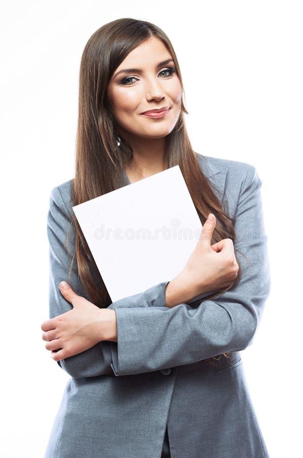 微笑与空白的白板的女商人画象 库存图片