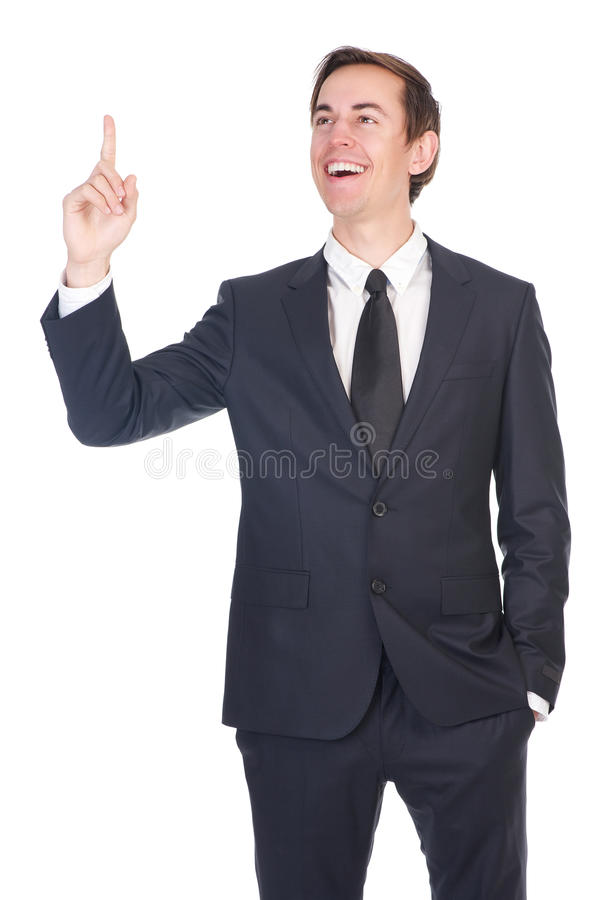 微笑和指向手指的愉快的商人 图库摄影