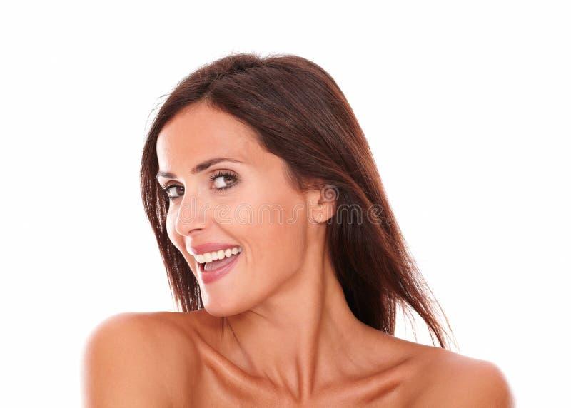 微笑对与肉欲的神色的照相机的妇女 库存照片
