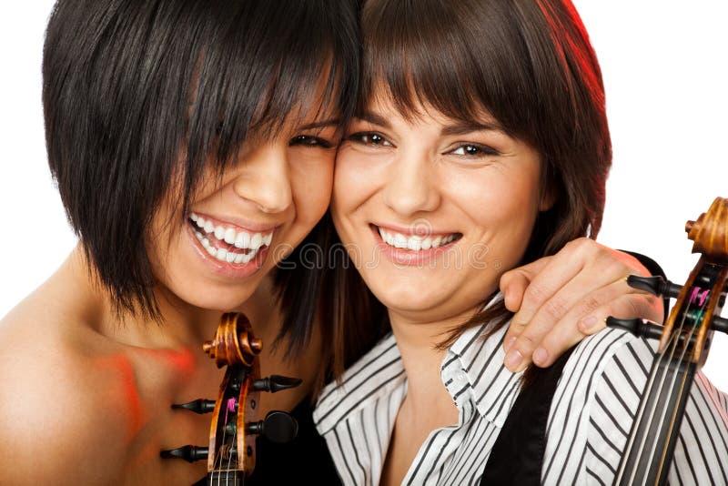 微笑对小提琴手的面颊 免版税库存照片