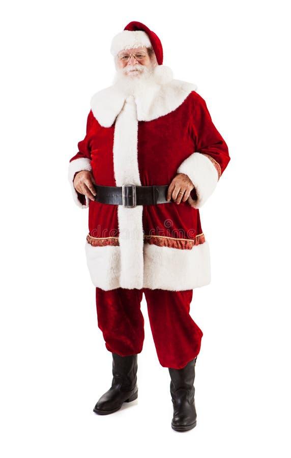 微笑对照相机的圣诞老人项目用在臀部的手 库存图片