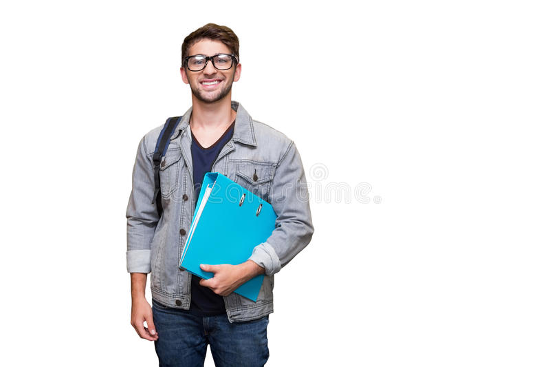 微笑对照相机的学生的综合图象在图书馆里 库存图片