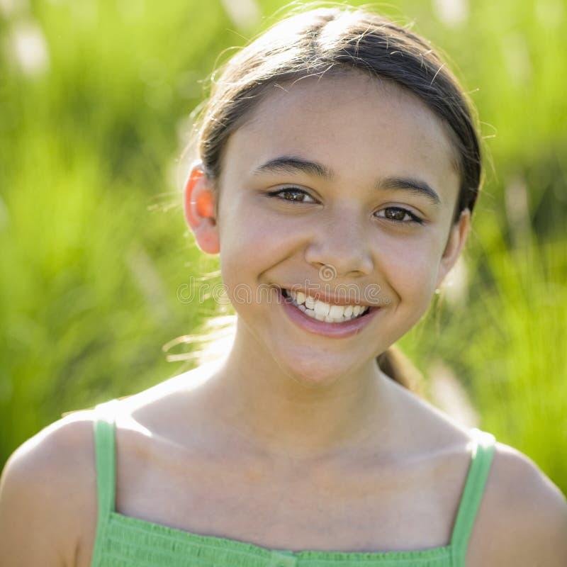 微笑对非离子活性剂的照相机女孩 免版税图库摄影