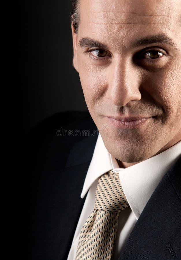 微笑成人生意人关闭的纵向  库存照片