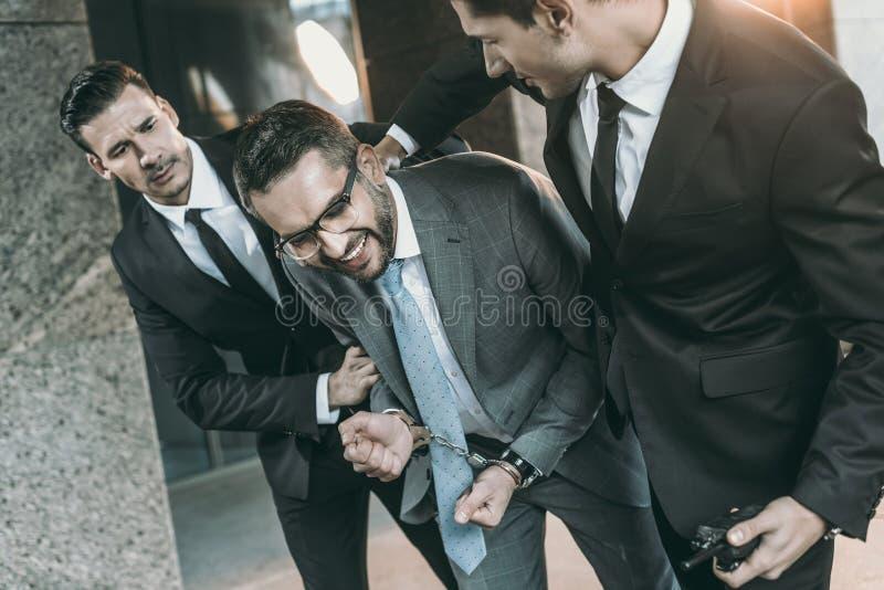 微笑拘捕的保安的播种的图象 库存照片
