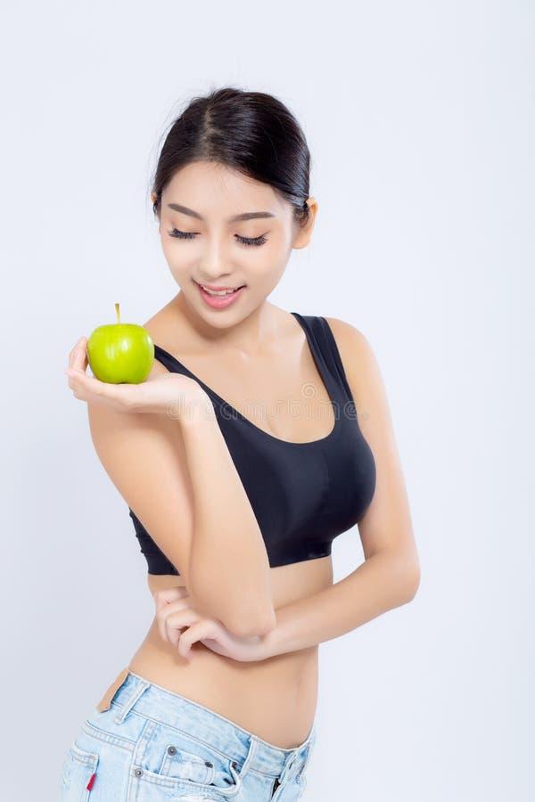微笑画象亚裔的妇女举行绿色苹果果子和好漂亮的东西或人 库存图片