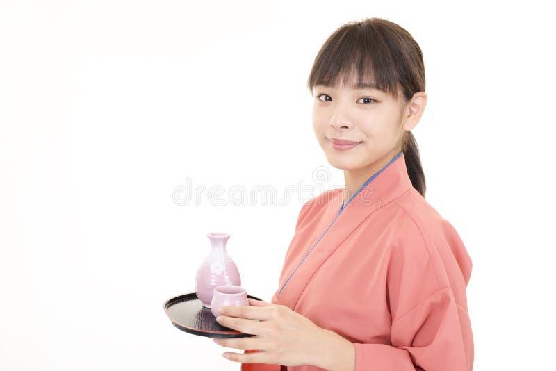 微笑的亚裔女服务员 库存照片