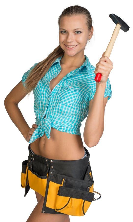 微笑的俏丽的女孩简而言之、衬衣和工具传送带 库存照片