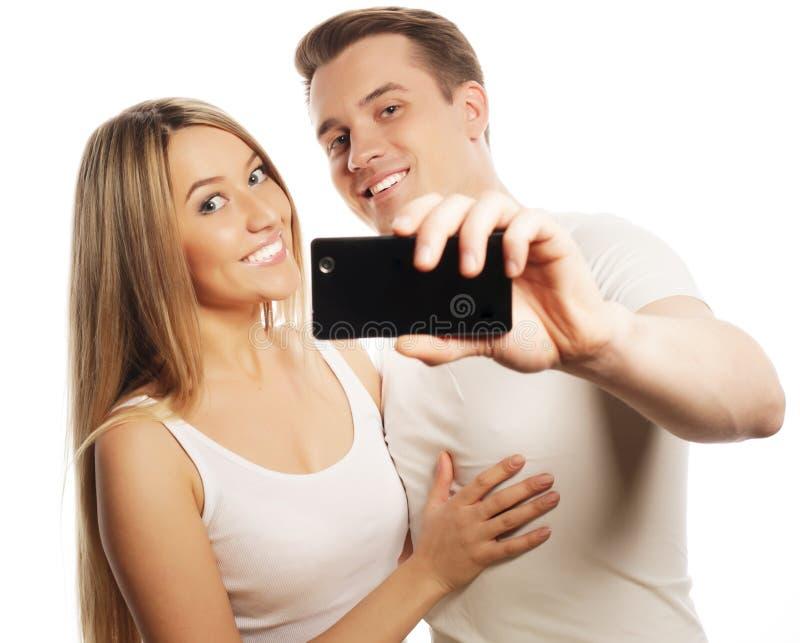 微笑的加上智能手机 免版税库存图片
