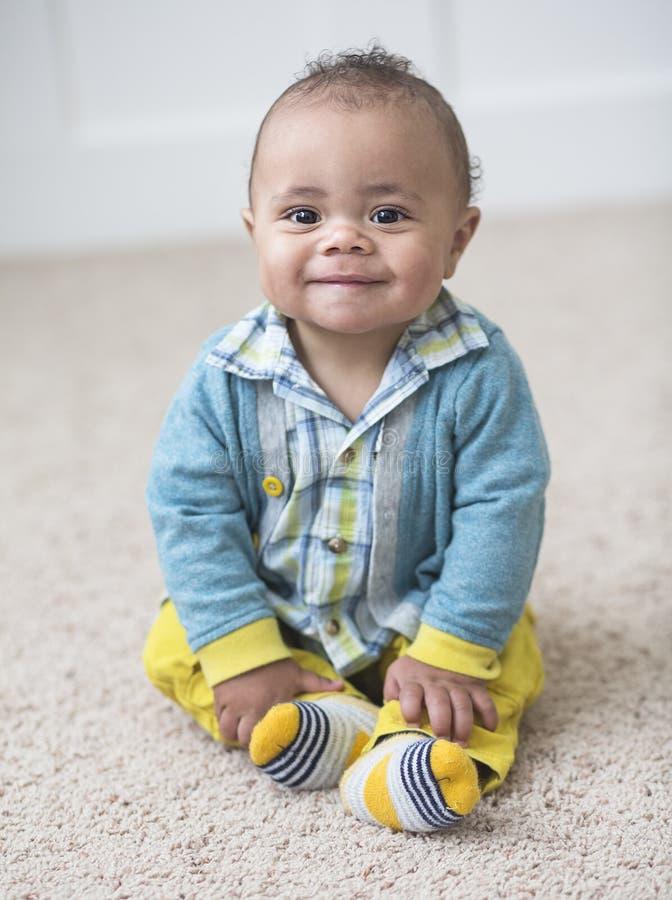 微笑的可爱的不同的男婴画象 免版税库存图片