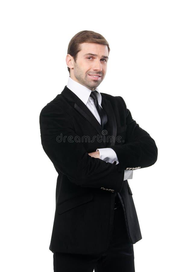 微笑的商人画象有横渡的胳膊的 图库摄影
