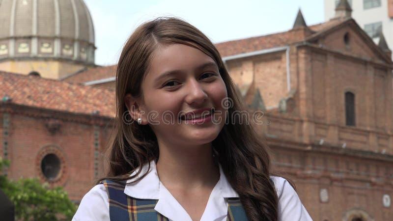 微笑的天主教学校女孩 免版税库存照片