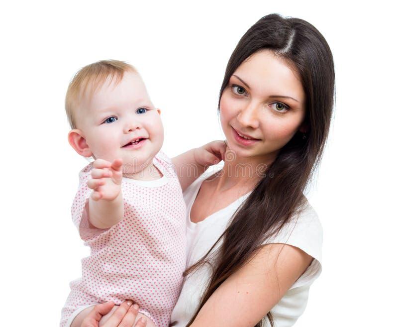 微笑的女婴和她的母亲纵向  免版税库存照片