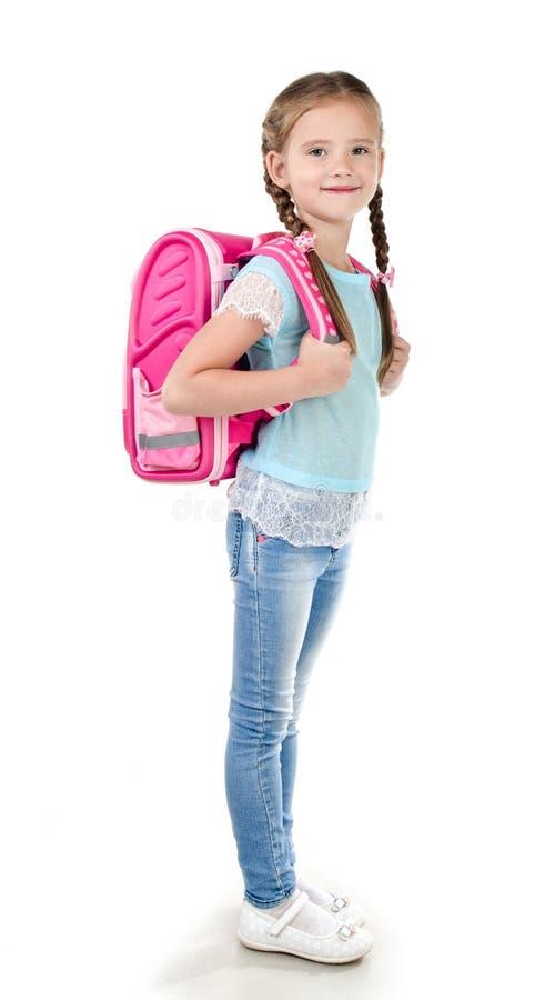 微笑的女小学生画象有书包的 免版税库存图片