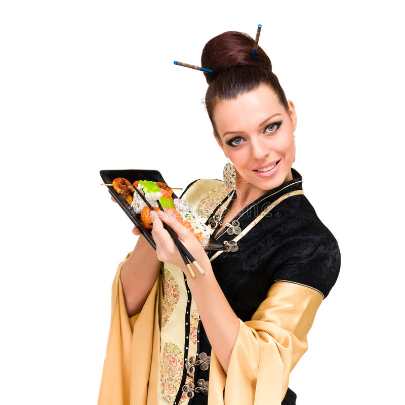 微笑的妇女用寿司 库存图片