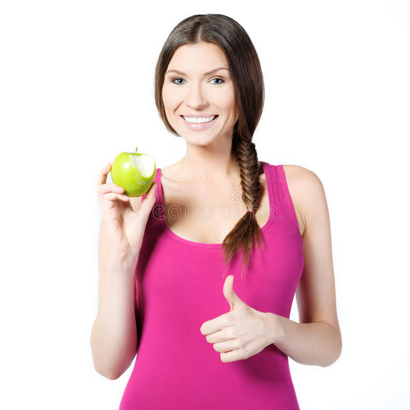 微笑的妇女用绿色苹果 免版税库存图片
